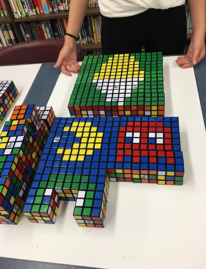Photo of completed images using Rubik's Cubes